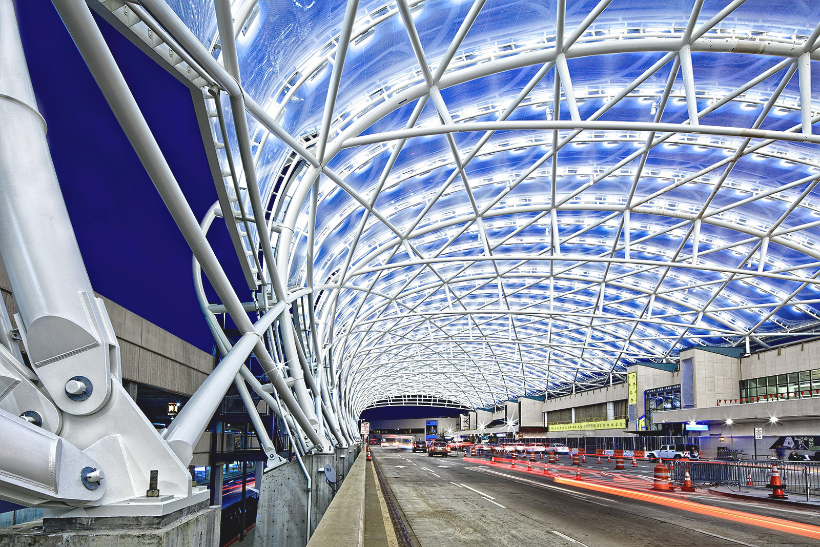 Exterior photography of the architectural design of the Hartfield Jackson Atlanta International Airport Canopies designed by HOK Architects. photo © Paul Dingman 2018. Paul Dingman is an architectural photographer based in Asia in China. He is a specialist in the photography of hotels, resorts, architectural design, and interior photography.
