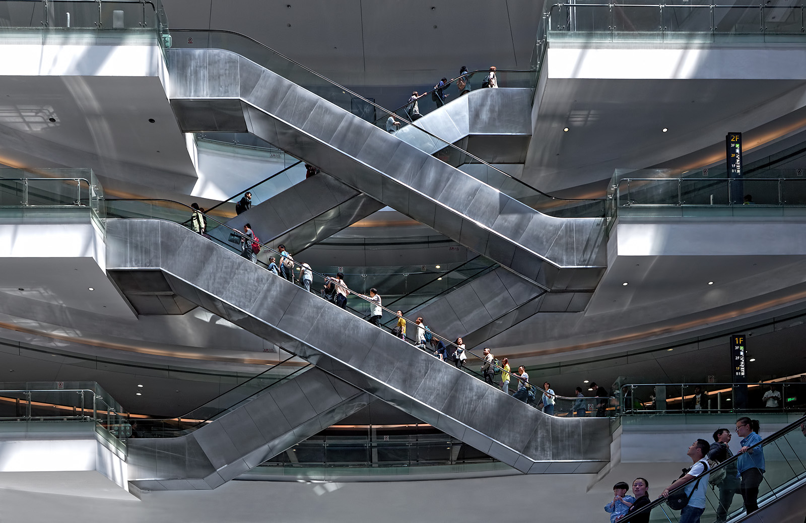 Architectural photography of the escalators at Hauqiao International Airport in Shanghai China. Paul Dingman is an architectural photographer based in China. He specializes in the photography of airports and transportation and large scale projects. He works throughout China and Asia.